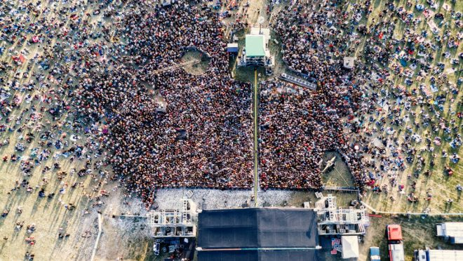 Summer music festival. People near stage. Top view