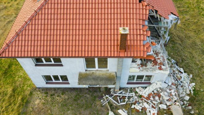 Aerial,View,On,Damaged,Red,Single,House,Roof,After,Strong